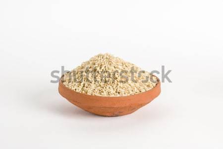 Organique brun riz argile bol santé Photo stock © vinodpillai