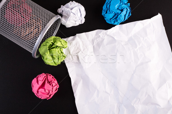 Creased color papers and office bin with crumpled white paper  Stock photo © viperfzk