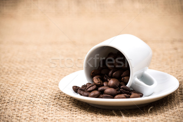 Coffeecup with coffeebeans on gunny textile Stock photo © viperfzk