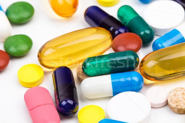 Különböző szín tabletták kapszulák makró lövés Stock fotó © viperfzk