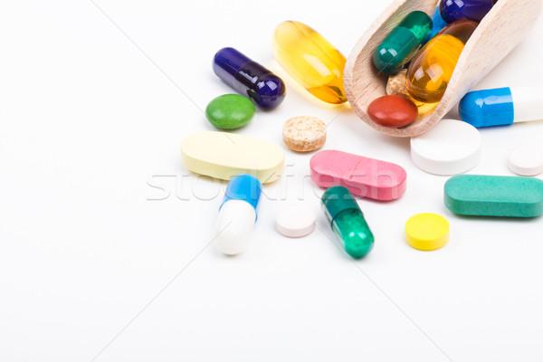 Különböző szín tabletták kapszulák fából készült orvosi Stock fotó © viperfzk