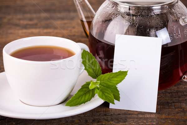 Stock fotó: Teáskanna · fehér · csésze · címke · sötét · fa · asztal