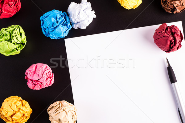Creased color papers on black table Stock photo © viperfzk