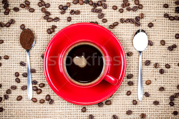 Coffee cup with coffee and sugar spoons on gunny textile Stock photo © viperfzk