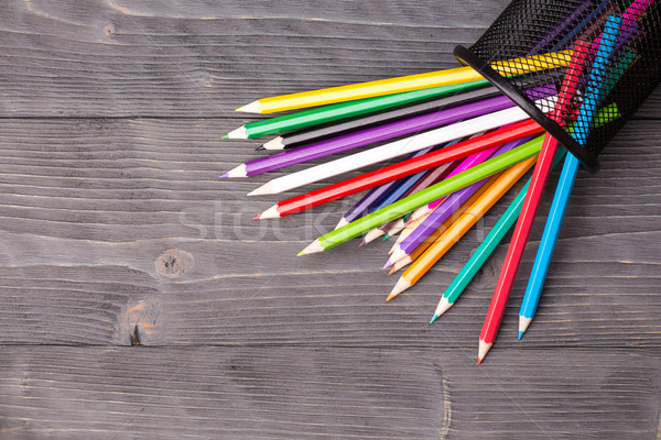 Color pencils and office bin on wooden background Stock photo © viperfzk