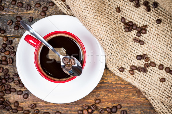 Coffee beans on spoon on top of coffee cup Stock photo © viperfzk