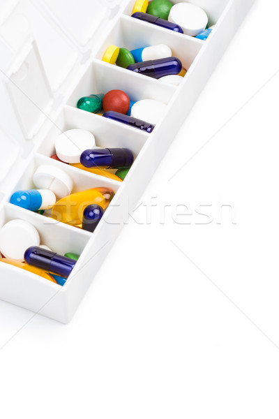 Color pills and capsules in pill organizer Stock photo © viperfzk