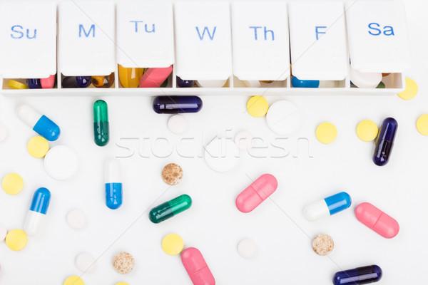 Szín tabletták kapszulák heti tabletta szervező Stock fotó © viperfzk