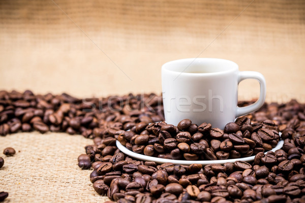 White coffeecup on coffeebeans Stock photo © viperfzk