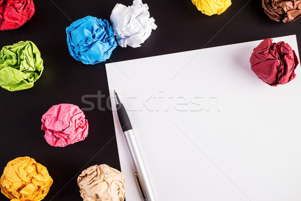 Creased color papers with white paper and ballpen Stock photo © viperfzk