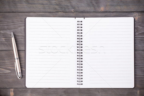 Office supply ballpen with notepad on wooden table  Stock photo © viperfzk