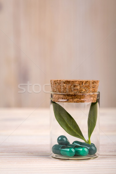 Alternative medicine with in glass container portrait view Stock photo © viperfzk