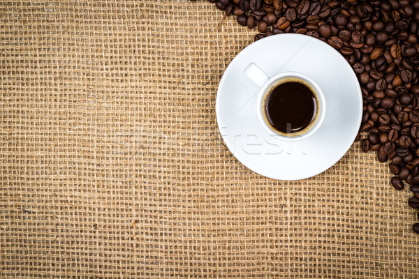 White coffeecup with coffee and coffeebeans Stock photo © viperfzk