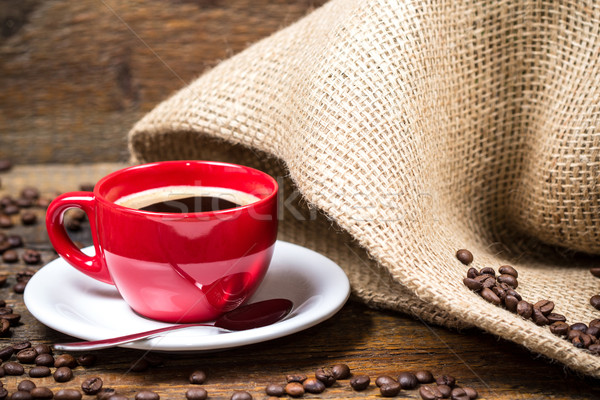 Coffee cup with coffeebeans and gunny textile Stock photo © viperfzk