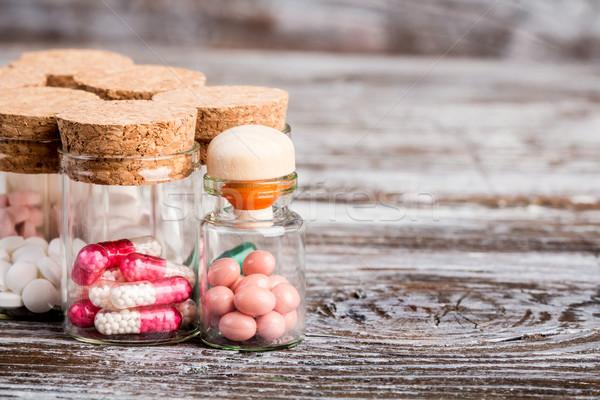 Különböző gyógyszer üveg dugó fa asztal orvosi Stock fotó © viperfzk