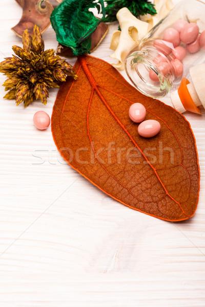 розовый мяча форма таблетки оранжевый лист Сток-фото © viperfzk