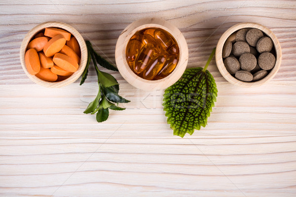 Various homeopathic pills and green leaves  Stock photo © viperfzk