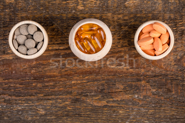 Alternative homeopathic medicine in wooden containers  Stock photo © viperfzk