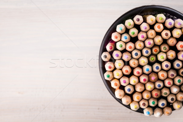Color pencils in a office bin on wooden background Stock photo © viperfzk
