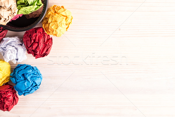 Creased color papers and office bin Stock photo © viperfzk