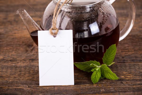 Teáskanna fehér címke sötét fa asztal természet Stock fotó © viperfzk