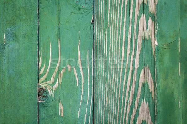 Klasszikus zöld viharvert fából készült kerítés textúra Stock fotó © viperfzk