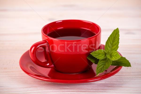 красный Кубок чай зеленые листья деревянный стол кофе Сток-фото © viperfzk