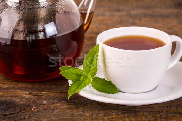 Teáscsésze teáskanna fa asztal sötét természet háttér Stock fotó © viperfzk