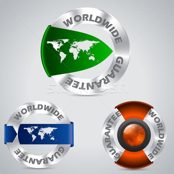 Partout dans le monde métallique garantir badges couleur Photo stock © vipervxw