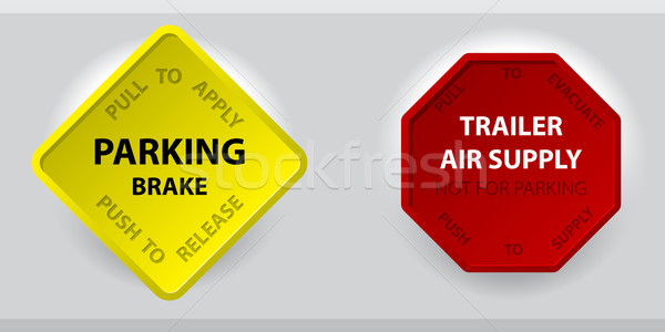 Stock photo: Truck parking brake knob and trailer air supply knob