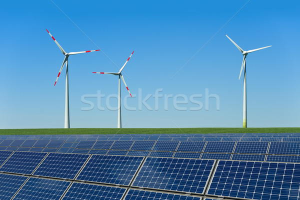 Solar panels and wind turbines in a field Stock photo © visdia