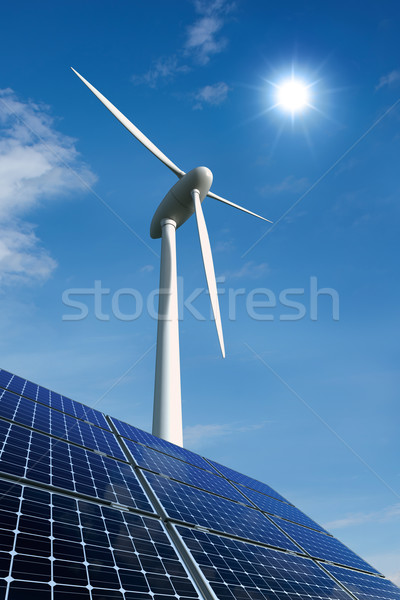 Stock photo: Solar panels and wind turbine against a sunny sky