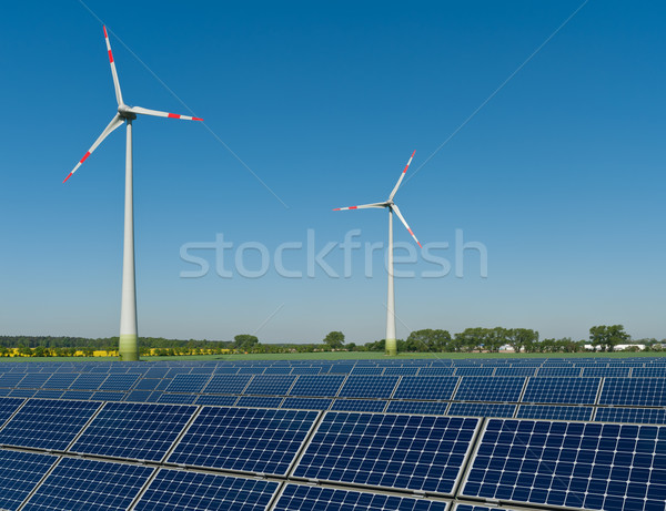 Solar panels and wind turbines against a rapeseed field Stock photo © visdia