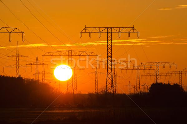 Stockfoto: Zonsondergang · achter · macht · lijn · zon · landschap