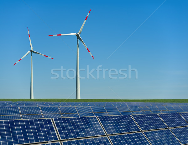 Wind turbines and solar panels in a field Stock photo © visdia