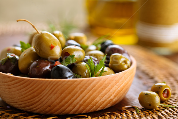 Marinated olives with herbs. Stock photo © Vitalina_Rybakova