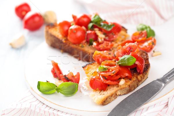 İtalyan gıda bruschetta lezzetli İtalyan kiraz domates fesleğen Stok fotoğraf © Vitalina_Rybakova