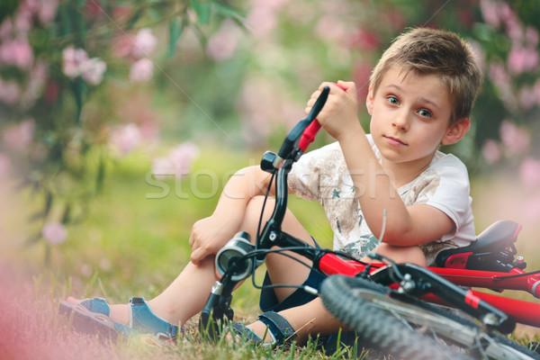 Fiú bicikli ül park család mosoly Stock fotó © Vitalina_Rybakova
