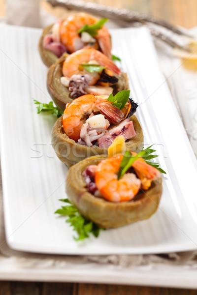 Gevuld harten zeevruchten witte plaat voedsel Stockfoto © Vitalina_Rybakova