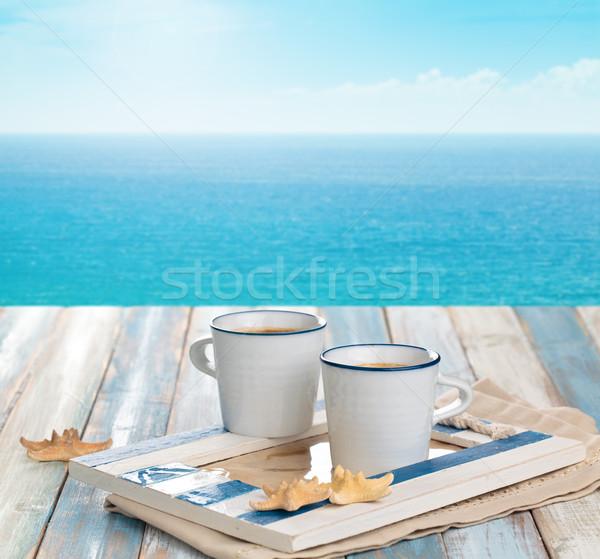 カップ コーヒーカップ コーヒー 木製のテーブル 青 海 ストックフォト © Vitalina_Rybakova
