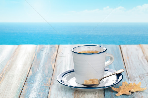 Fincan kahve fincanı kahve ahşap masa mavi deniz Stok fotoğraf © Vitalina_Rybakova