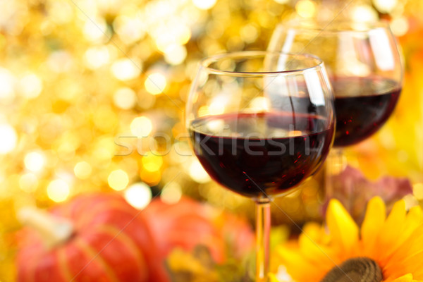 Autumn arrangement with wine, sunflowers and pumpkins. Stock photo © Vitalina_Rybakova