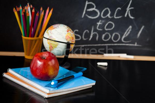School supplies against blackboard. Stock photo © Vitalina_Rybakova