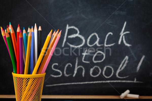 Colorful pencils and  blackboard. Stock photo © Vitalina_Rybakova
