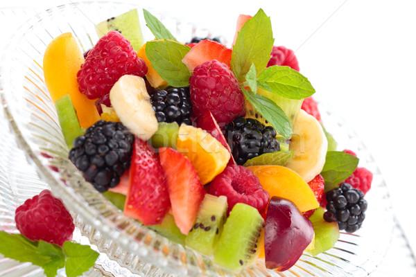 Taze meyve salata meyve salatası krem çanak yalıtılmış Stok fotoğraf © Vitalina_Rybakova