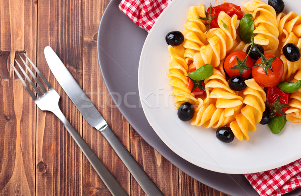 Cucina italiana pasta italiana pomodorini olive nere basilico Foto d'archivio © Vitalina_Rybakova