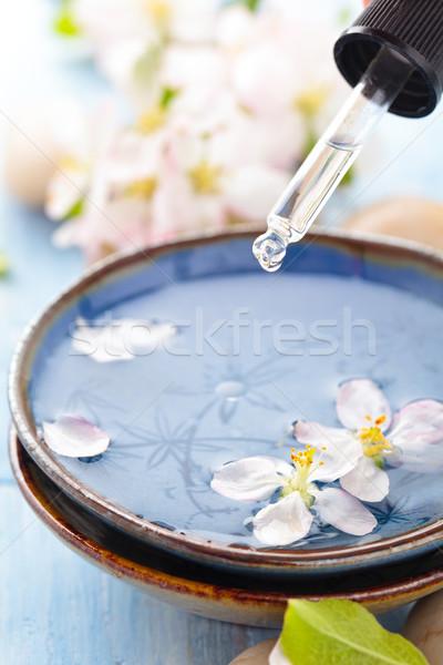 Water bloemen olie lentebloemen spa Stockfoto © Vitalina_Rybakova
