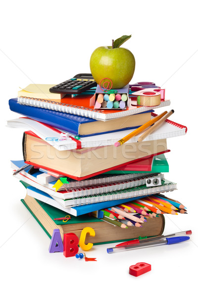 Stock photo: School supplies and green apple isolated on white background.