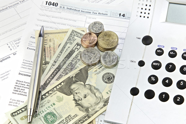 Adó visszatérés dollár bankjegyek számológép 1040 űrlap Stock fotó © Vividrange