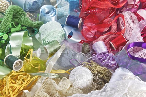 Couture art vert bleu tissu rouge Photo stock © Vividrange